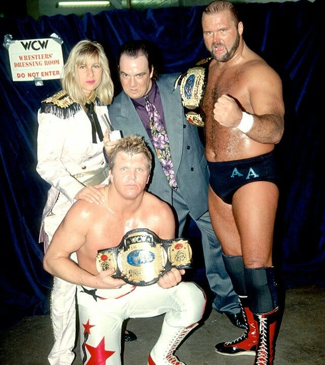 Madusa alongside fellow members of The Dangerous Alliance, WCW tag champs Bobby Eaton and Arn Anderson, and Paul E. Dangerously.