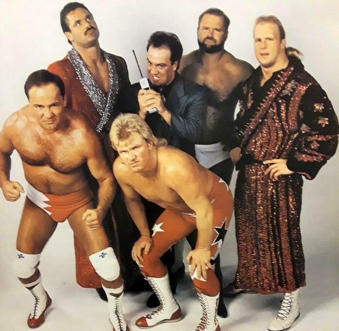 The Dangerous Alliance - Larry Zbyszko, Rick Rude, Bobby Eaton, Paul E. Dangerously (Paul Heyman), Arn Anderson, and Stunning Steve Austin