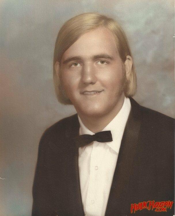 Teenage Hulk Hogan posing in his senior year high school photo.