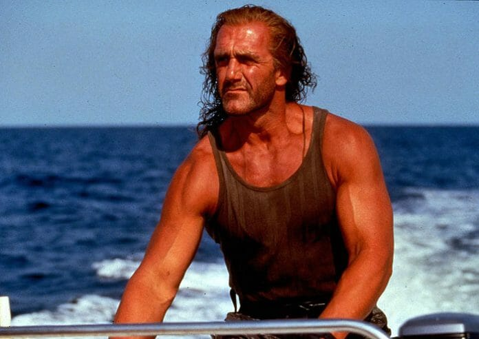 Hulk Hogan with a full head of hair in the movie Shadow Warriors.