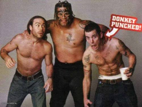 Umaga poses with his two victims, Chris Pontius and Steve-O of Jackass.