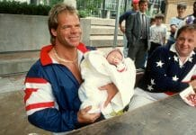 Lex Luger holding a baby during the height of the Lex Express tour, because why not?