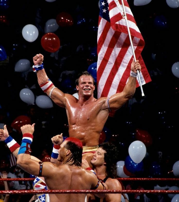 Lex Luger celebrates his countout victory over the Yokozuna alongside fan favorites Tatanka and Scott Steiner of the Steiner Brothers at SummerSlam '93