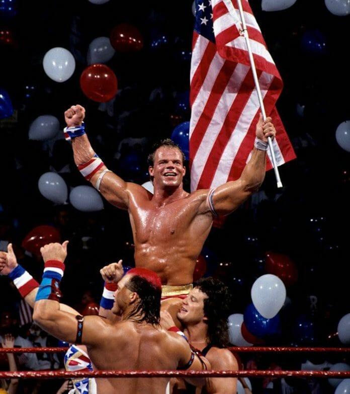 Lex Luger celebrates his countout victory over Yokozuna alongside fan favorites Tatanka and Scott Steiner at SummerSlam '93.
