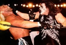 Sting attacks nWo member Hollywood Hulk Hogan at WCW Starrcade, December 28. 1997.