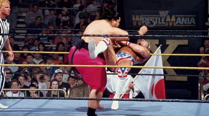 Yokozuna delivers a stiff clothesline to Lex Luger during their March 20th, 1994 WrestleMania 10 match. This would be the first of two matches for Anoa'i.