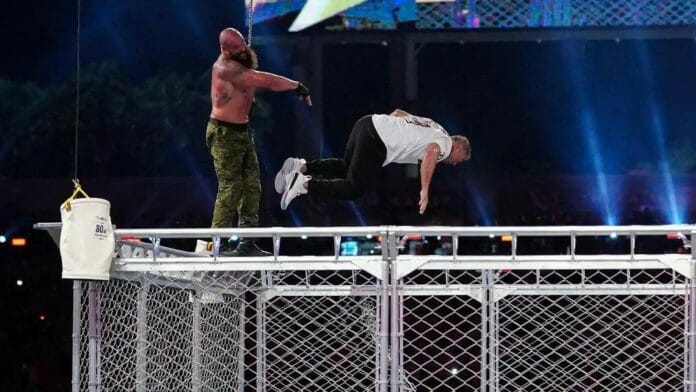Braun Strowman throws Shane McMahon off the top of a steel cage at WrestleMania 37.