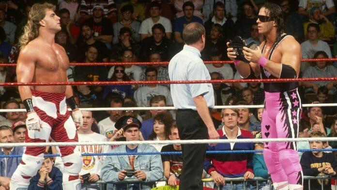 WWF Intercontinental Champion Shawn Michaels faces off against WWF World Heavyweight Champion Bret 'Hitman' Hart at November 25, 1992's Survivor Series pay-per-view.