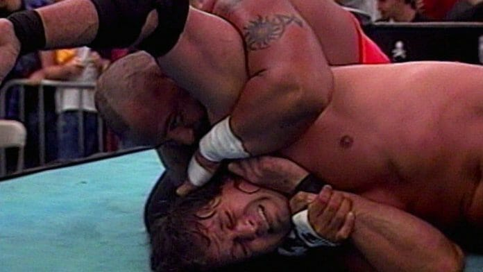 WCW's Mike Awesome defends the ECW World Championship against WWE's Tazz on April 14, 2000