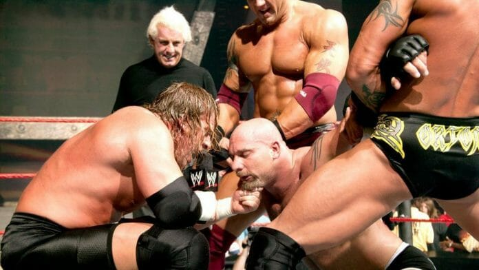 Triple H, Ric Flair, Bautista, and Randy Orton of Evolution team-up against Goldberg.