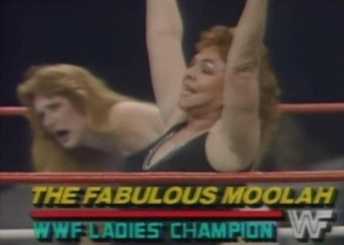 The Fabulous Moolah celebrates her controversial win over Velvet McIntyre at WrestleMania 2.