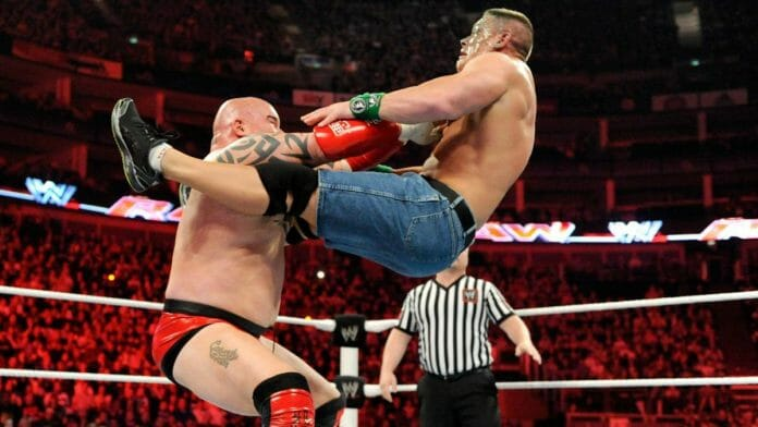 Lord Tensai sets John Cena up for the Baldo Bomb after spitting green mist in his head. Tensai would soon later gain the upset victory over Cena.