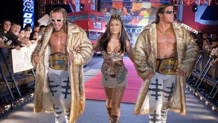 The flashy MNM, Joey Mercury and Johnny Nitro alongside Melina.