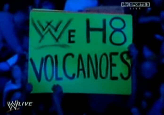 A fan holding up an anti-volcano sign as Triple H addressed the audience. WWE RAW Nightmare! | The Volcanic Eruption That Forced Big Changes