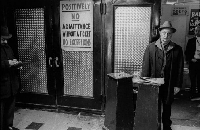 friendly ticket collector greets fans just inside Sunnyside Garden Arena. [Photographer/Copyrighted by: Arthur Nager, author of the book Wrestling at Sunnyside Garden Arena.]