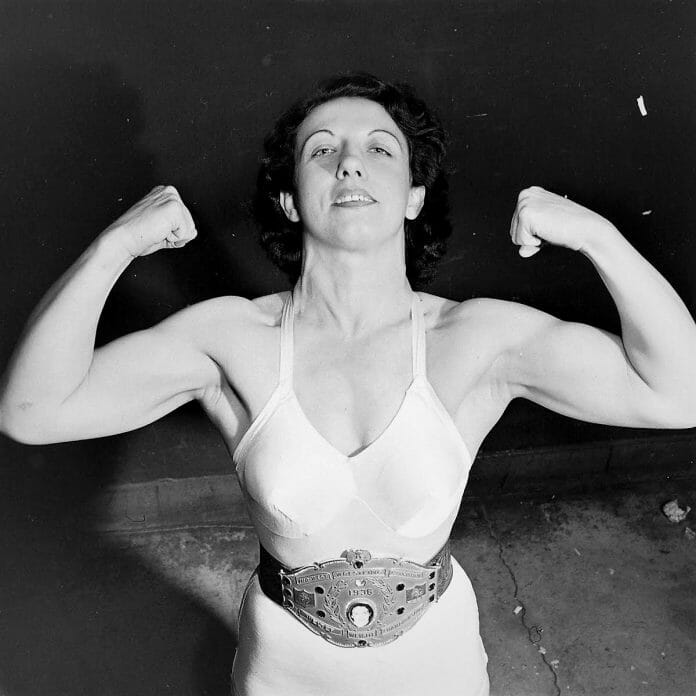 After defeating Clara Mortensen, the nearly two-decade championship run for the legendary Mildred Burke was only just beginning. Here, she poses with her Midwest Wrestling Association Welterweight Championship belt.