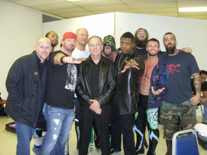 Wrestling super-agent Bill Behrens (center) alongside Ring of Honor talent at the time: Jay Lethal, AJ Styles, BJ Whitmer, Delirious, Caprice Coleman, Evan Bourne, and The Briscoe Brothers.