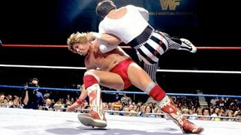 Sam Houston in the WWF, executing an armdrag against Danny Davis.