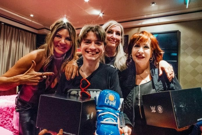 "GLOW originals Hollywood, Roxy Astor, and Eileen ""MTV"" O'Hara with a happy fan on the AfterGLOW cruise in 2018."
