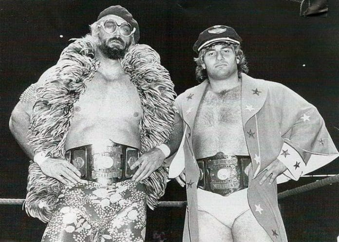 "The East-West Connection - Jesse ""The Body"" Ventura and Adrian Adonis as AWA Tag Team Champions in 1980."