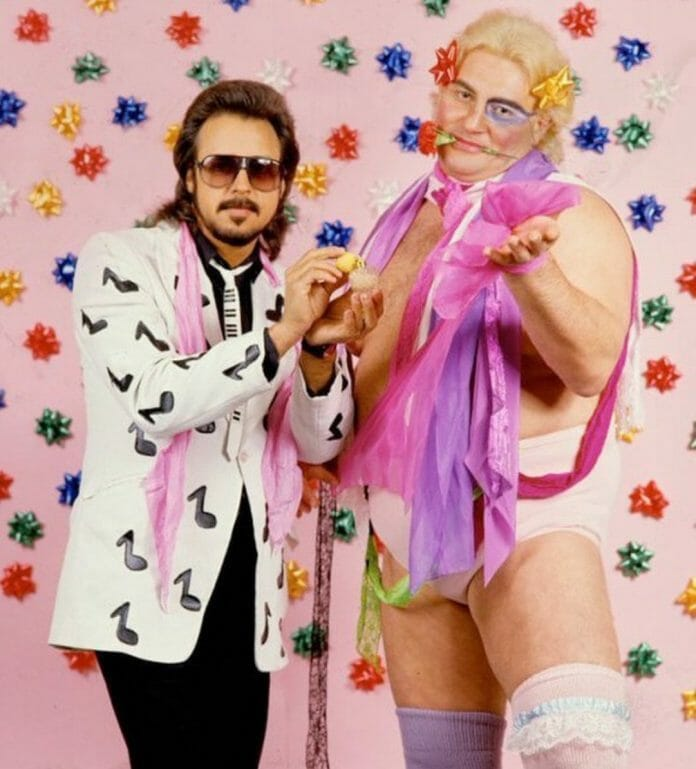 Adrian Adonis after reinventing his look, alongside manager Jimmy Hart.