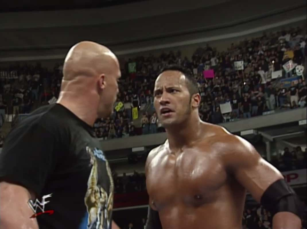Looking angry, The Rock and Stone Cold stick to the storyline in the ring.