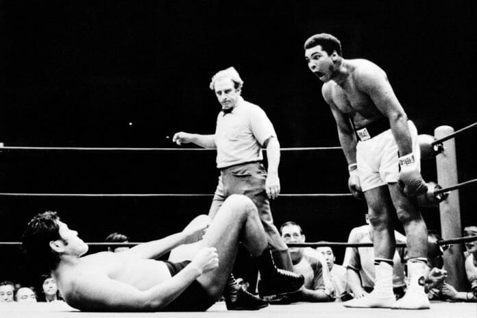 If Muhammad Ali expected a worked exhibition, he was probably not pleased with the repeated kicks to his legs he took by Antonio Inoki. Ali is seen here taunting Inoki as referee Gene LeBell looks on.