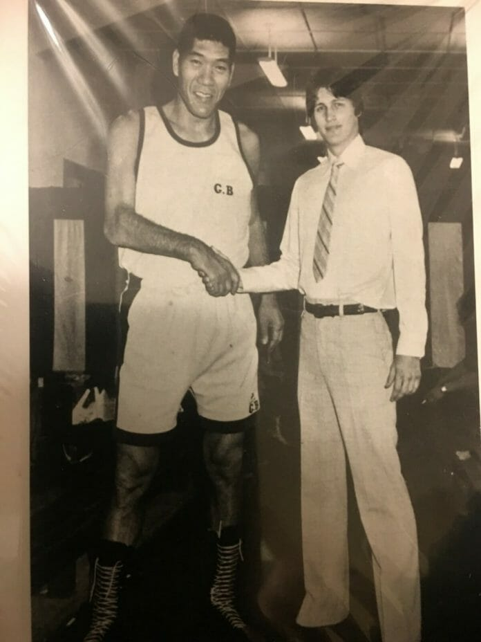 A young Bruce Tharpe alongside Japanese professional wrestler and promoter Giant Baba.