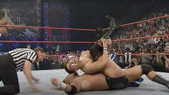 Taka Michinoku goes for the pin on Triple H during their WWE Championship match on Raw, April 10th, 2000.