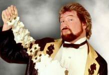Ted DiBiase showing off his Million Dollar Championship belt. [Photo courtesy of WWE.com]
