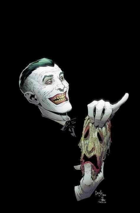The Joker holds the skin of his face on the front cover of Batman Volume 7: Endgame.