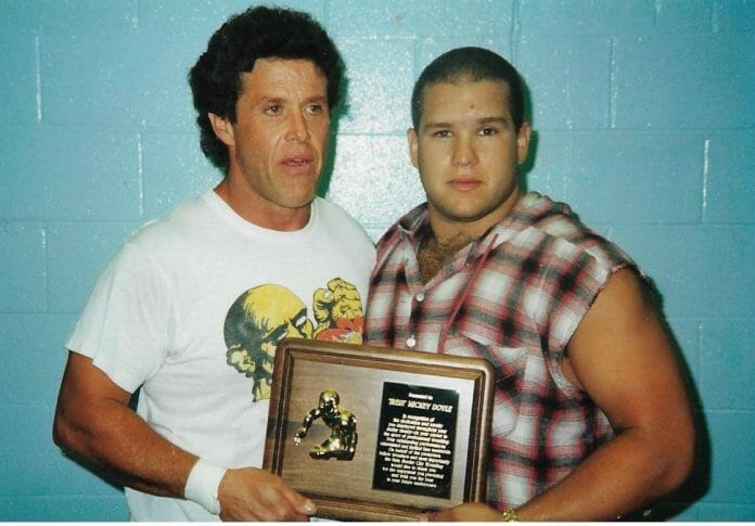 Mickey Doyle presented a plaque by a young Scott F. D'Amore.