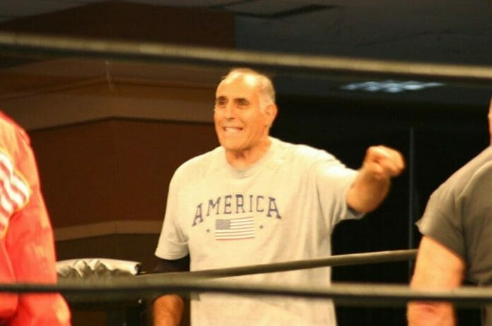 Dominic DeNucci sharing a ring with Nikolai on August 27, 2005. [Photo copyright: Christine J Coons]