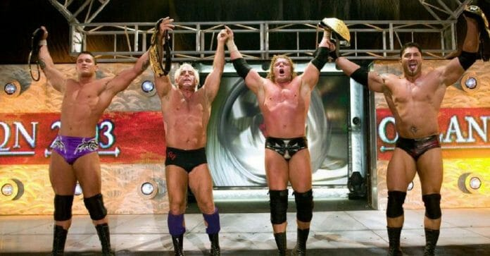 "Ric Flair as part of the WWE stable ""Evolution"" with Randy Orton, Triple H, and Batista."