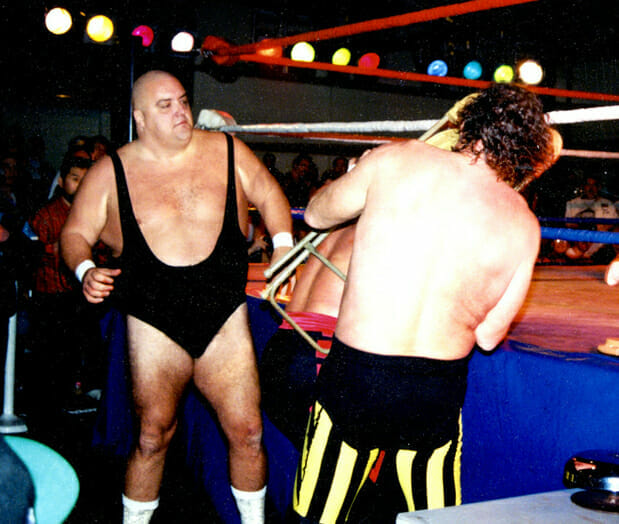 King Kong Bundy battling Terry Funk in ECW at 1993's NWA ECW November to Remember event.