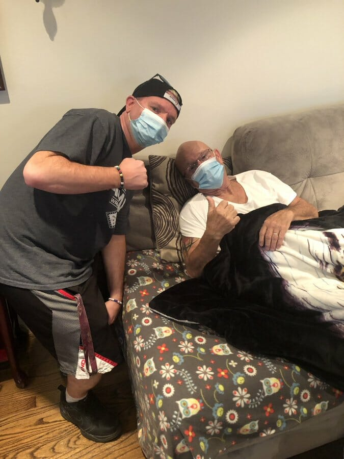 James Ellsworth next to a recovering Gillberg Duane Gill after suffering a heart attack.
