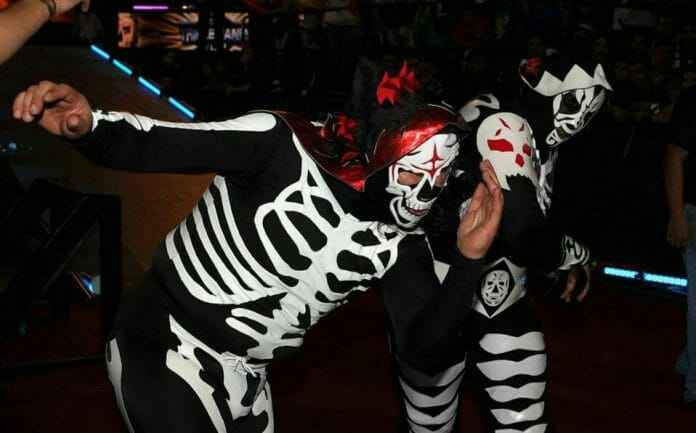 The original La Parka (as L.A. Park) lets the second La Parka know who should be wearing the skeleton outfit during AAA's mega-event called Triplemania XVIII.