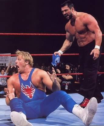 Steve Blackman unmasks The Blue Blazer to reveal Owen Hart.