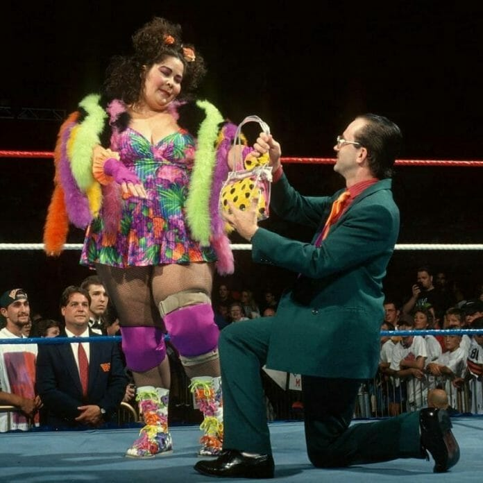 Harvey Wippleman being a gentleman to Bertha Faye. They are considered by many as one of the most undesirable couples in the history of WWE.