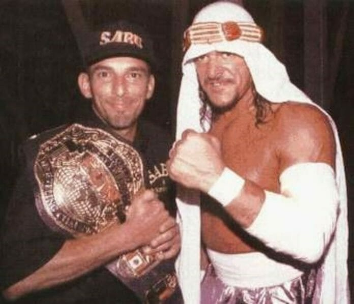 Bill Alfonso and Sabu with his arm bandaged up in ECW.