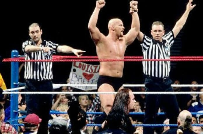 """""""Stone Cold"""" Steve Austin celebrates his victory at 1997's Royal Rumble pay-per-view."""