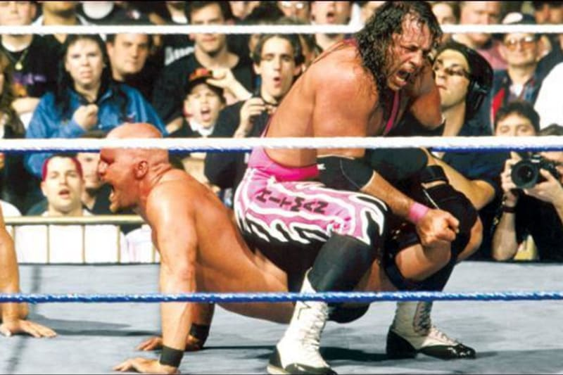 """In one of WrestleMania's most iconic moments, Bret Hart applies the Sharpshooter on """"Stone Cold"""" Steve Austin at WrestleMania 13."""