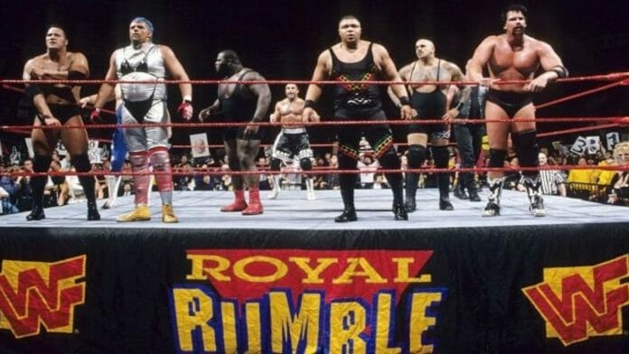 """3... 2... 1..."" The Rock, The Artist Formerly Known as Goldust, Mark Henry, Marc Mero, D-Lo Brown, Kama Mustafa, and ""Blackjack"" Bradshaw awaits the next entrant at 1998's Royal Rumble."