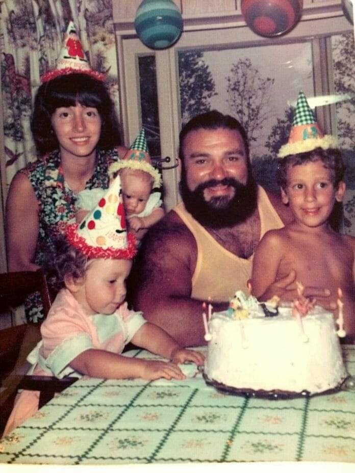 Proud father Pampero Firpo takes part in a birthday celebration with his family. Mary Fries is the youngest and is seen here being held by her mother.