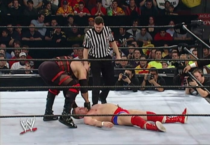 Kane trying to lift an unconscious William Regal post-concussion.