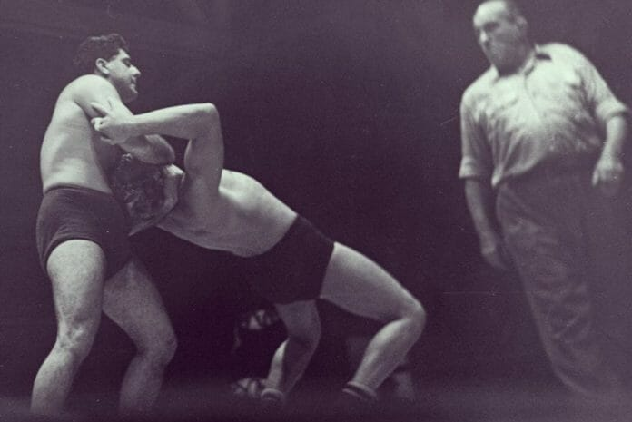 Angelo Savoldi, left, has an opponent in a headlock during a 1948 match in California.