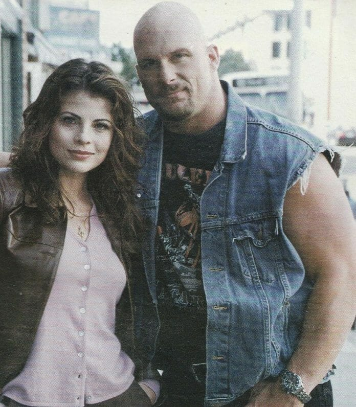 Stone Cold Steve Austin with co-star Yasmine Bleeth on the set of the TV show Nash Bridges back in 2000.