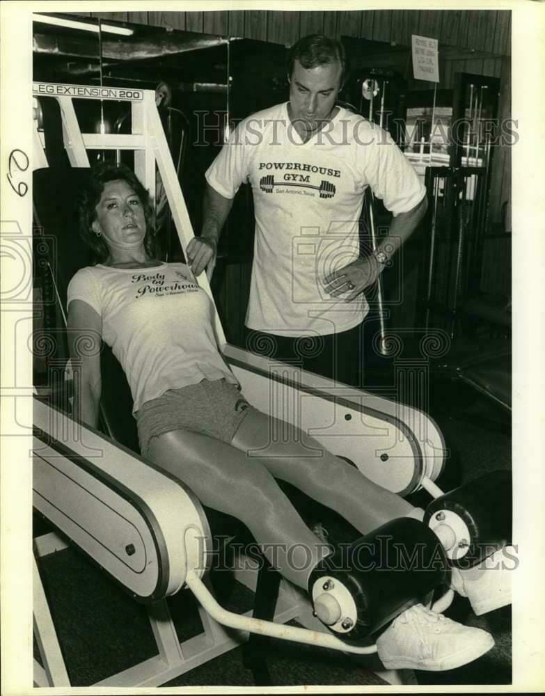 A 1985 press photo showing Evelyn Stevens working out with her husband Frank Riegle at the gym. About a year later, a couple's disagreement would turn to tragedy. [Photographer: Jose Barrera / Stock Photo: HistoricImages.com]
