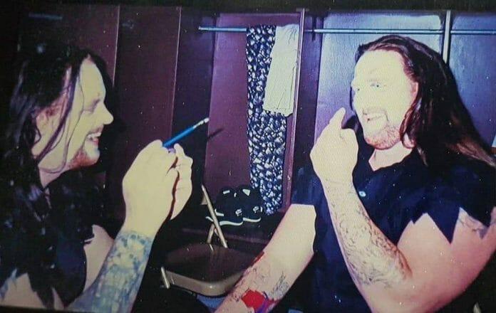 "Undertaker applies face paint on ""fake Undertaker"" Brian Lee before SummerSlam '94."