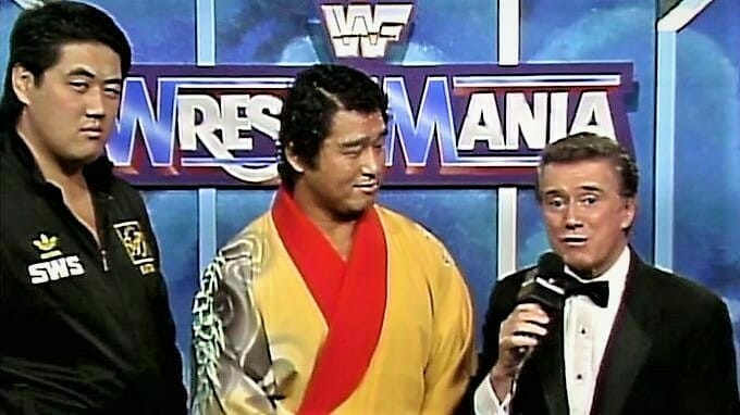The team of Kōji Kitao (left) and Genichiro Tenryu, seen here with Regis Philbin, defeated Demolition (Smash and Crush) at WrestleMania VII. A week later, Kitao would get into a shoot fight with John Tenta in Japan.